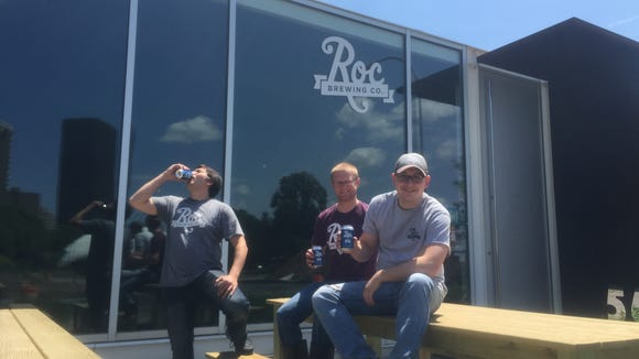 Nick Mesrobian, head brewer, left, Josh Hunt, assistant brewer/chef, middle, and Chris Spinelli, co-founder, outside Roc Brewing.