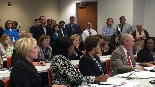 Valerie Nagoshiner, from left, Raquel Hatter, Marie Williams and a room full of onlookers listen to  Douglas Varney, commissioner of the Department of Mental Health and Substance Abuse Services, right, tell a panel of lawmakers about the state's mental health needs on Tuesday, May 31, 2016.