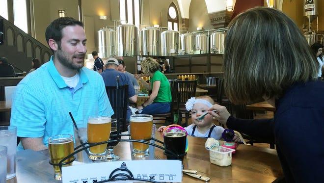Jordan Kriel, left, Emerson Kriel, middle and Erin Kriel, right, test out St. Joseph Brewery which allows kids.
