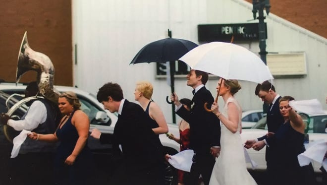 Dr. Blake Alberts and bride Shannon Thompson lead a second line dance down Texas Street to their reception.