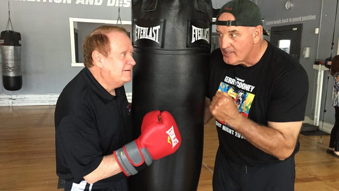 Former New Jersey Gov. Richard Codey, left, and former boxing great Gerry Cooney enjoy a friendly sparring match on Wednesday, May 12, 2016, at Aces Boxing Club in Boonton, to drum up publicity for a charity boxing event.