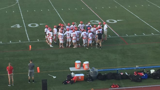 The Red Hook High School boys lacrosse team talks things over during a timeout on Wednesday at Faller Field in the Section 9 Class C title game.
