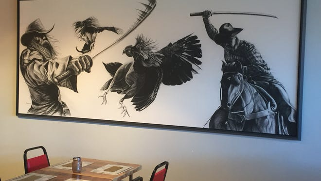 A charcoal image of cowboys wielding samurai swords reflects Kauboi Izakaya's blending of Japanese and Western motifs. The Japanese-inspired tavern opens June 1 in Midtown Reno.