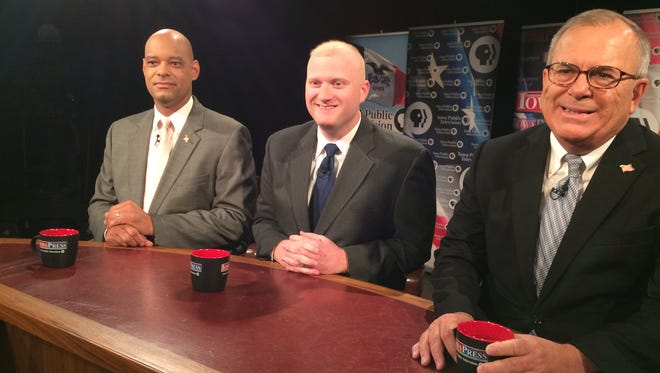 Democrats Desmund Adams, Jim Mowrer and Mike Sherzan, from left, discuss their race for Iowa's 3rd Congressional District on June 3 in Johnston.