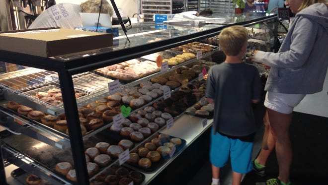 Choices, choices. Guests at Jack's Donuts grand opening choose from nearly 40 different kinds of doughnuts.