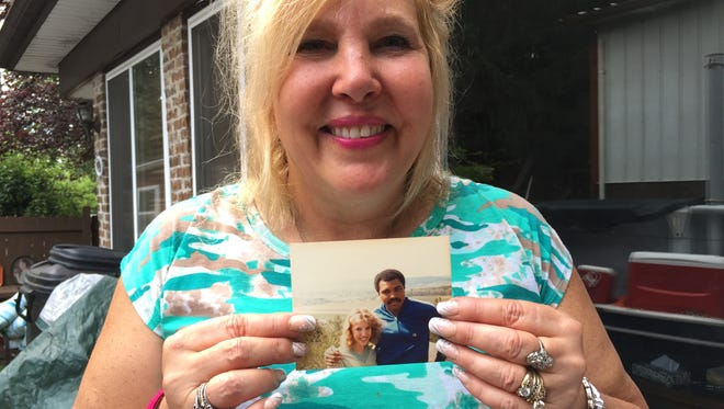 Nancy Small, of Spring Garden, holds up a photo she has of herself and Muhammad Ali. She got to meet Ali in 1980 at his training camp in Deer Lake.