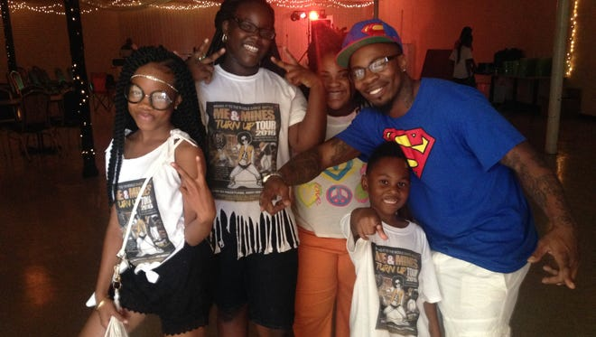 Talihay Chapell, left poses with her friends and her father Terry Wooten, right before the Me&Mines Turn Up Tour 2016 Dance Battle at MyPlace in Montgomery Sunday night.