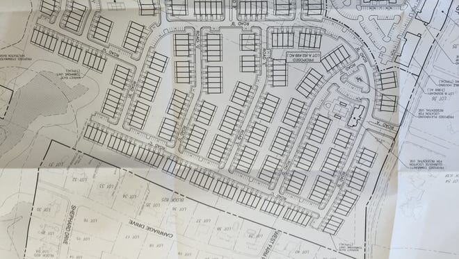 A photograph of a site plan showing the layout for 350 townhomes behind the proposed shopping center on Route 35 at Kings Highway.  At the bottom of the picture is a new road that would run parallel to Route 35.