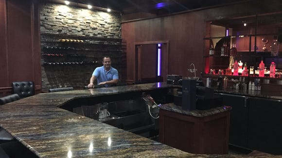David Dashi, owner, sits at the bar in The Chef's Table.