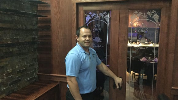 David Dashi, owner of The Chef's Table, shows off the