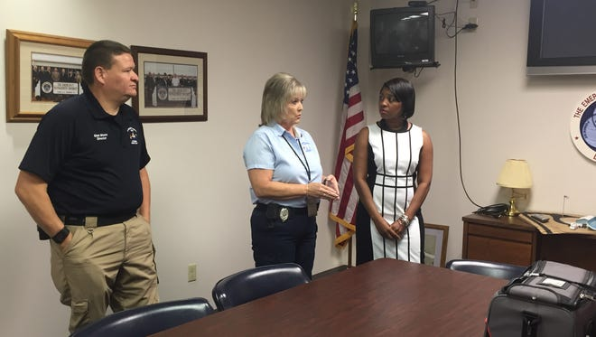 From left: Glen Moore, Debbie Windham and Chinika Hood speak about Smart911 Tuesday at the Forrest County Emergency Management District.