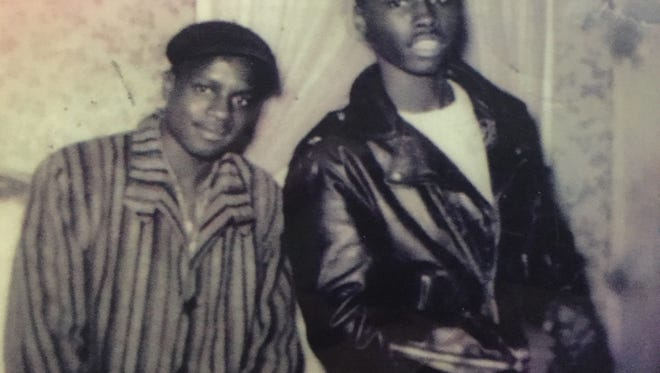Alvin Clark (left) as a teenager in Dallas with a cousin. By this time, he was already working long hours at a hotel.