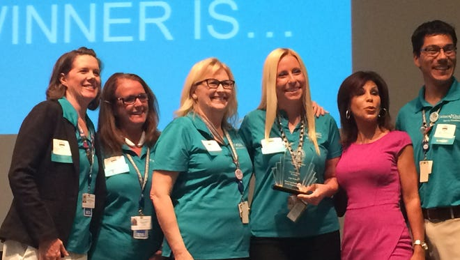 Staff from Desert Arc receive their Workplace Wellness Award grand prize on Tuesday, June 7, 2016.