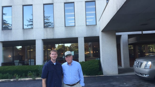 Businessman Charles Jones (right) stands in front of one of the five buildings on the 53-acre former Nashville Memorial Hospital campus with Luke Nafziger, who worked with the Institute of Basic Life Principles.