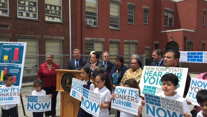 Yonkers students and  officials rally outside School 17 for state approval of a plan to rebuild the city's old, overcrowded school buildings.