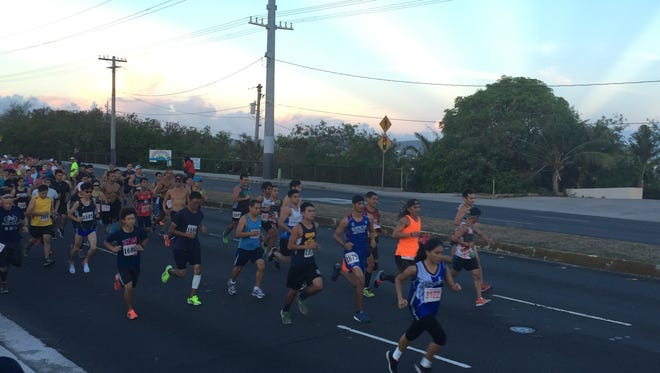 Runners take off during the start of the 7th Annual Nissan 7.5K Flag Run on June 11 in Upper Tumon.