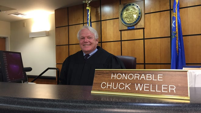 Reno Family Court Judge Chuck Weller sits in his courtroom nearly 10 years to the day after an assassination attempt.