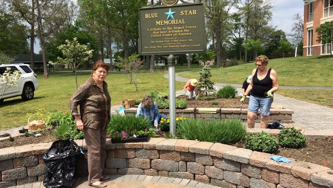 (From left) Paula Carman of Pittsgrove, Gail Robinson of Vineland, Irene Bird of Millville and Col. Barbara Ann Logan, USAF Ret., of Millville, members of the Countryside Garden Club, spruce up the Blue Star Memorial Garden at the New Jersey Veterans Memorial Home in Vineland.