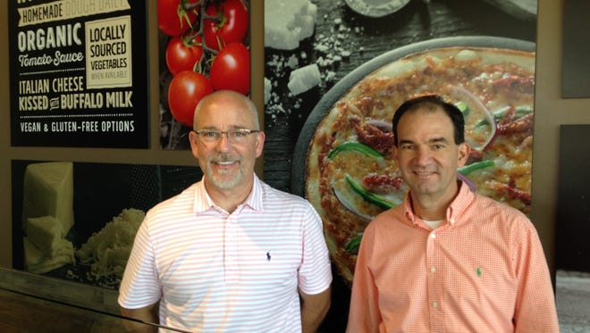 Robby Stewart and Andres Bolivar co-own PizzaRev, 1150 Vann Drive