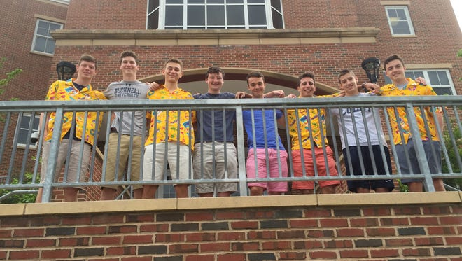 From left: Ethan Wilens, Jack Weitzner, Simon Geisker, David Husselbee, Jack Starkey, David Friedman, Zack Bernstein and Jack Cloud, juniors at Sleepy Hollow High School, convinced nearly 60 students and several faculty members to wear the same ugly Hawaiian shirt on picture day.