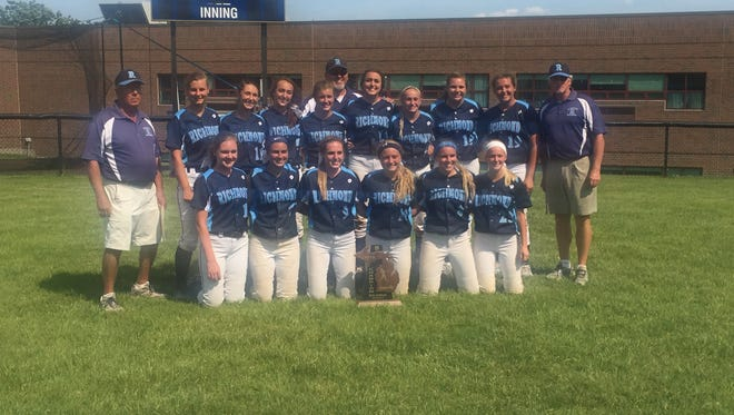The Richmond High School softball team poses for a photo after winning the Division 2 regional softball championship at Detroit Country Day