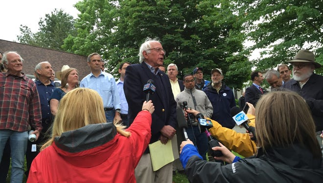 Sen. Bernie Sanders speaks outside his home in Burlington, Sunday, June 12, 2016. He met with close advisers there in the afternoon.