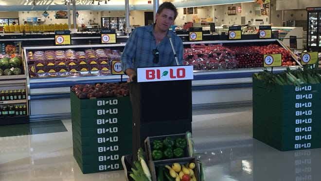 Celebrity chef Curtis Stone speaks at the Simpsonville BI-LO at Highway 14 Monday.
