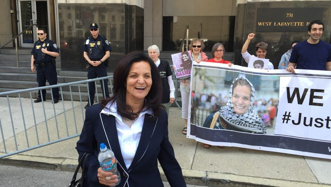 Rasmieh Odeh, 69, leaves federal courthouse in Detroit on June 13, 2016, as her supporters rally.