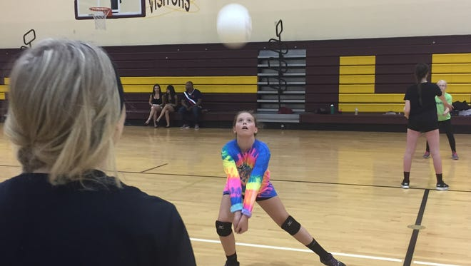 Licking Heights fifth-grader Bella Skeie practices passing with sophomore Abby Hyde during the Hornets' youth camp June 9.