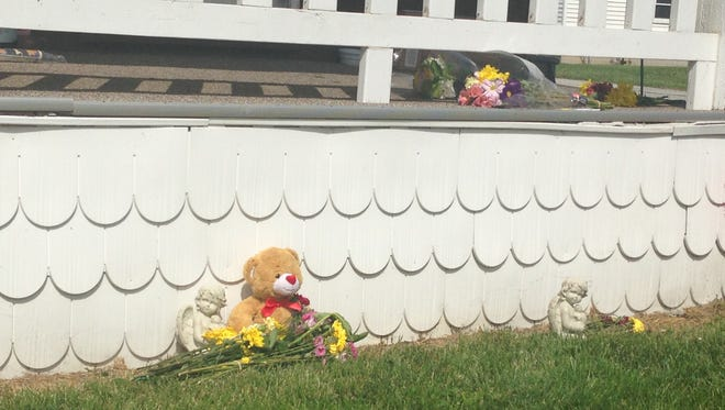 Flowers and a teddy bear were left at the home of Codie Powell, 9, who was killed Sunday in an alleged murder-suicide.