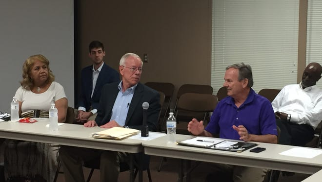 Superintendent Verna Ruffin, School Board Chairman Jim Campbell and County Commissioner Gerry Neese talk about school funding at a committee meeting Tuesday.