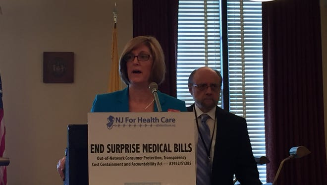 Maura Collinsgru, health care program director for New Jersey Citizen Action, and Raymond Castro, senior policy analyst for New Jersey Policy Perspective, call on lawmakers to rein in out-of-network charges at a State House news conference on Thursday, June 16, 2016, in Trenton.