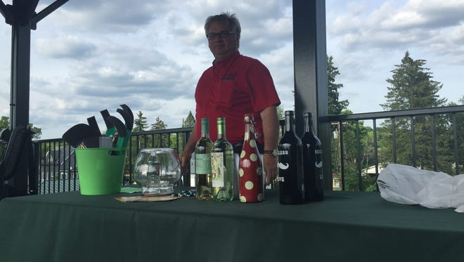 Bruce Conard, the wine expert of the night, checks his selection of wines for the night.