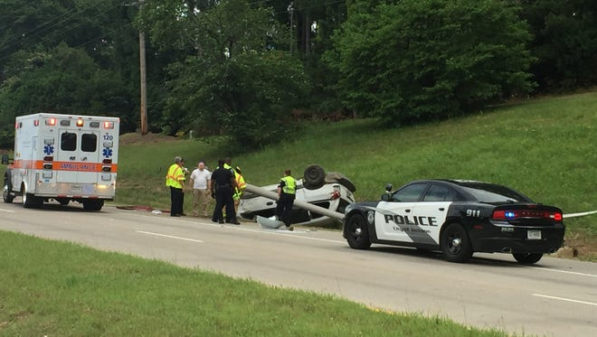 The Jackson Police Department and an ambulance respond to a single vehicle crash on the Highway 45 Bypass Sunday morning.