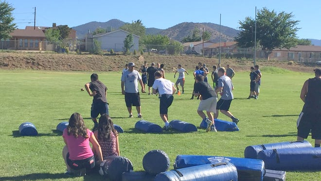 Silver High head football coach Raul Diaz is working on agility drills with his student-athletes.