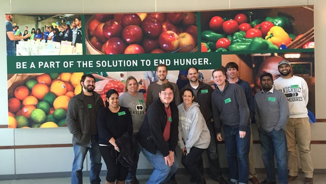 The team at Entrada volunteers at Second Harvest Food Bank.