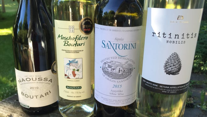 Greece makes many wines other than the pine-flavored retsina, shown at right. From left are Boutari Naoussa, a red wine, and white wines Boutari Moschofilero and Santorini Assyrtiko.