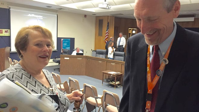 In this June 21, 2016 photo, retiring member of the Wicomico County Board of Education, Carolyn Elmore, chats with school district Comptroller Bruce Ford after the final meeting of the 2016 fiscal year. Elmore retires effectively June 30.