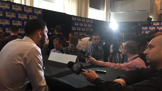 Denzel Valentine answers questions from reporters Wednesday afternoon in New York ahead of Thursday's NBA Draft. Among the topics, the health of his knees.
