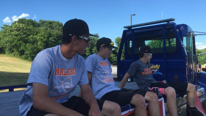 Members of the Marlboro High School baseball team get ready to ride their float in a victory parade held Wednesday.