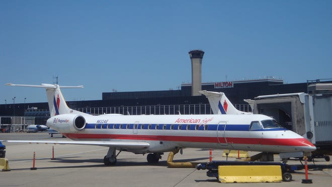 An Embraer ERJ-145 regional jet is seen in American's old American  Eagle livery at Chicago O'Hare International Airport on July 11, 2009.