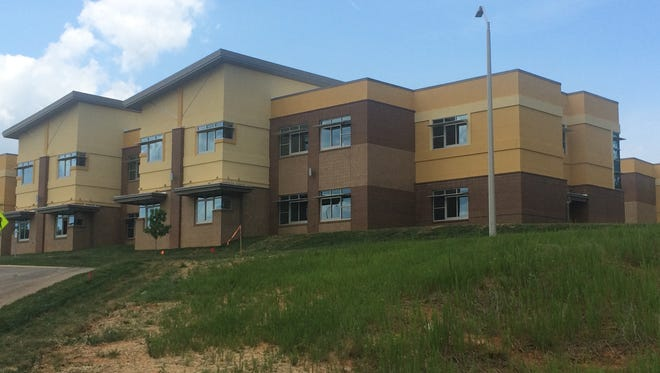 The new Enka Intermediate School's bright yellow cover has generally garnered positive reviews, a school official says.