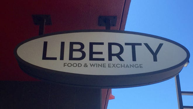 The sign above the entrance to Liberty Food & Wine Exchange, chef Mark Estee's new restaurant occupying part of the space of his former Reno Provisions.