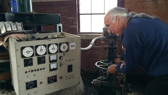 Chuck Pheiffer adjust the flow of water while he checks the electrical output of the Friendship Dam June 23, 2016.