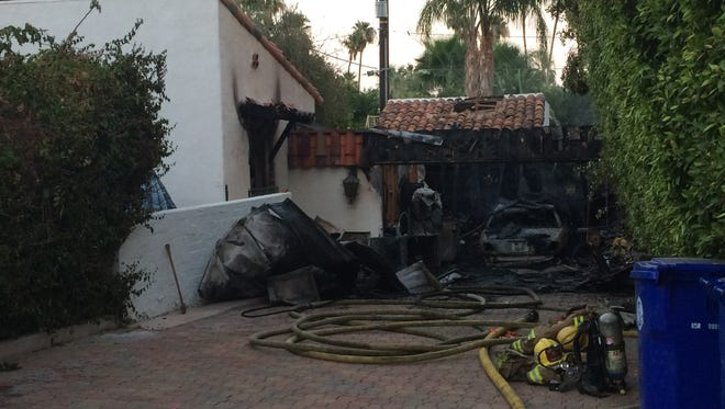 A car and garage were destroyed in a two-alarm fire at Mesa Drive and Overlook Road in Palm Springs Saturday night.