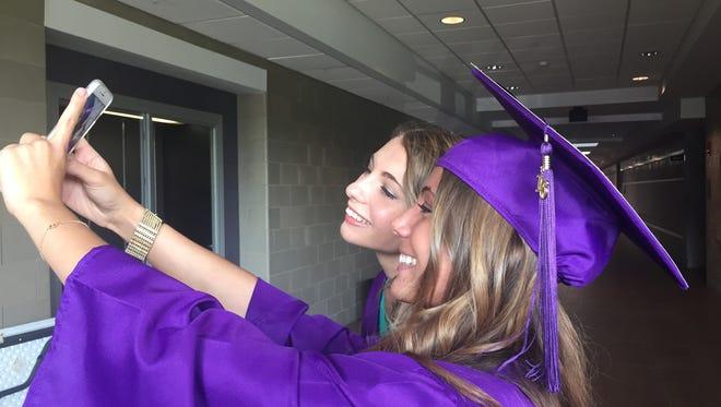 Rhinebeck High School graduates and twin sisters Rhinebeck High School graduates and twin sisters Victoria Grubiak, left, and Julia Grubiak take a selfie.
