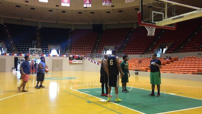 Jackson police play basketball during a tournament Saturday morning at Oman Arena to benefit a police department dispatcher's cancer treatment.