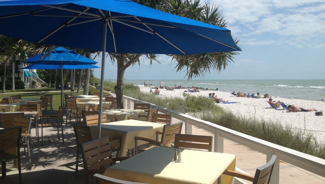 Unless it's raining, get a table on the patio facing the Gulf of Mexico.