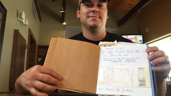 Dwyer's Cafe co-owner Brett Dwyer shows a receipt for more than $7,000 that was accidentally rung up for one of the tables Loula Mae Landry waited on. The longtime waitress died Monday.