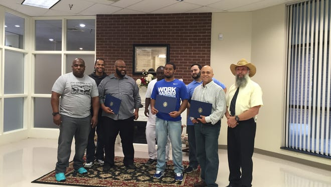 Students from Camden County's Welding Technology program show their certificates.